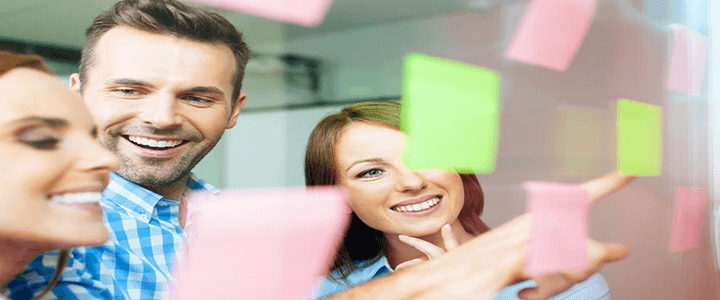 stock photo of women and man looking at sticky notes