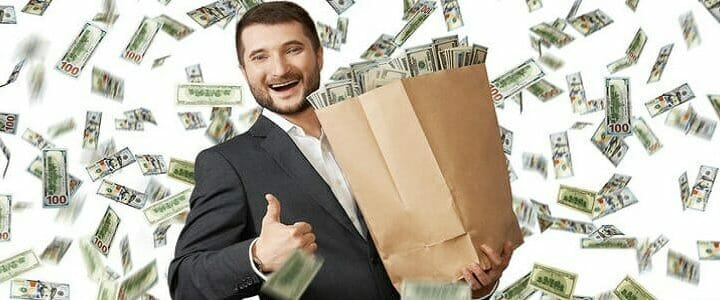 stock photo of man with bag of money and money raining down