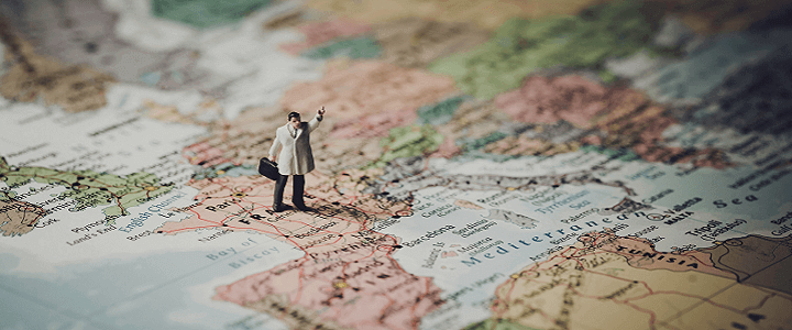 stock photo of small man figure on map of Spain