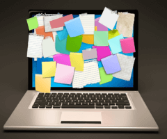 Stock photo of computer covered in sticky notes