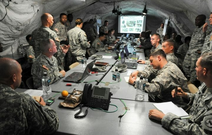 Planning meeting in US military tent