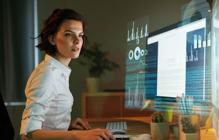 Futuristic photo of woman working and screenless computer